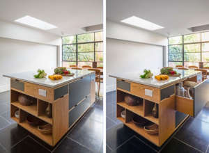 Large kitchen island in a London remodel by MW Architects with two-story bespoke plywood cabinets | Remodelista