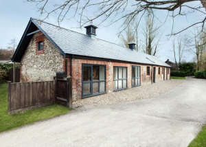 AR Design converted Manor House stable exterior: Remodelista