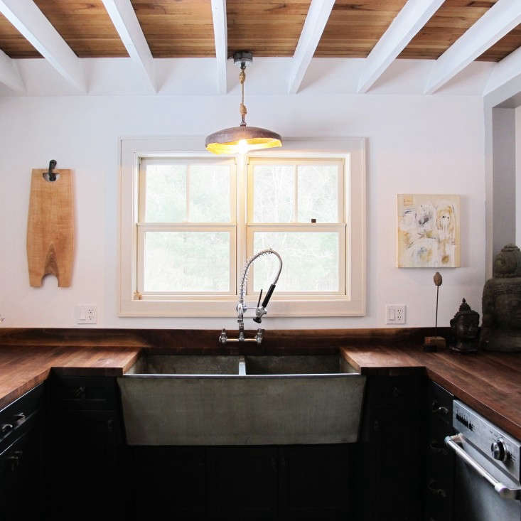 A U-shaped kitchen takes up half of the back wall of a house in Ulster County, New York, owned and designed by Megan Sommerville and Matt Ensner of Materia Designs. For more, see our post American Gothic: A Hudson Valley Home Reborn.