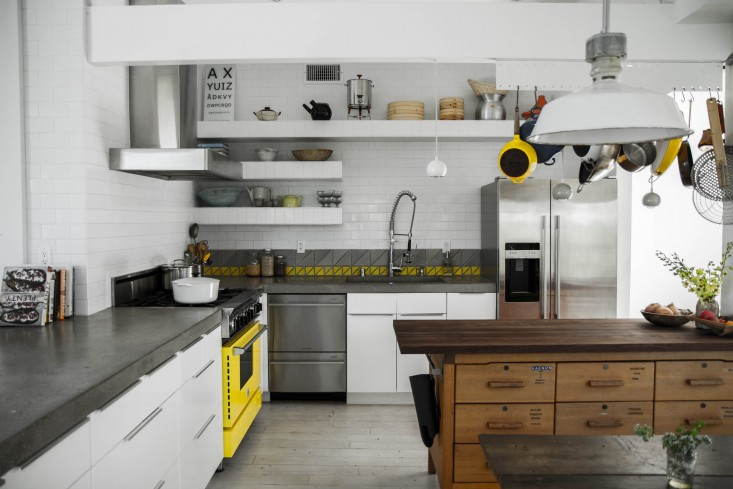 above the yellow bluestar range is what my then six year old called the centerpiece of the kitchen vintage calart gray and yellow triangle tiles were