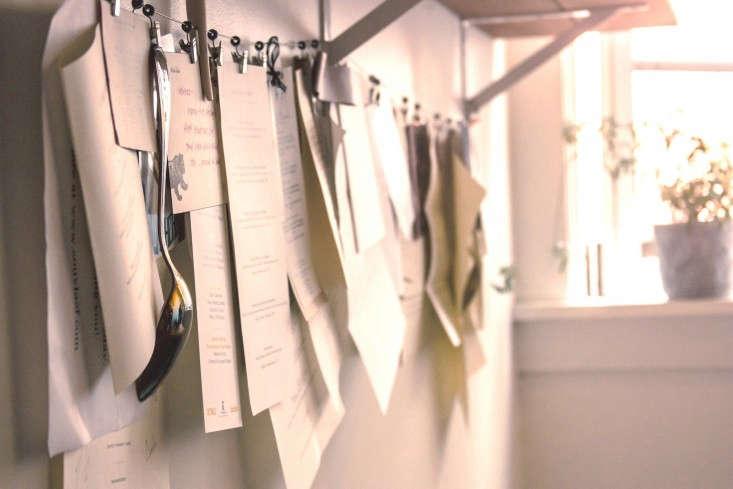 Menus-hanging-on-line-in-kitchen-Remodelista