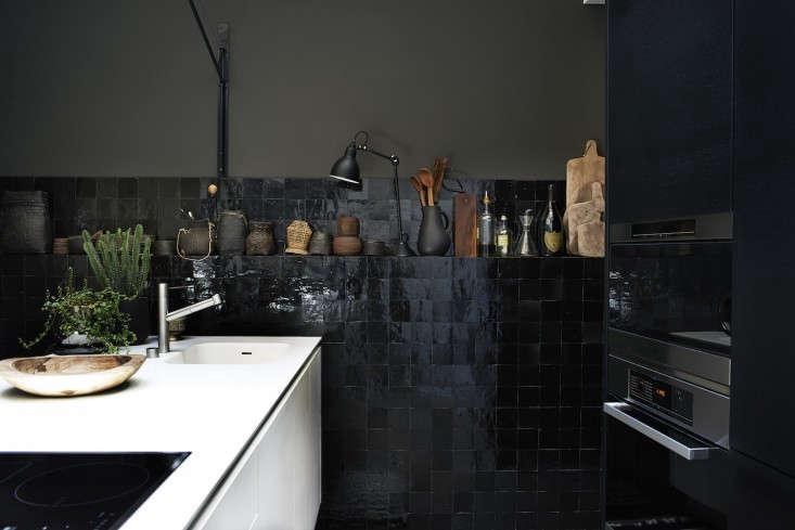 Monochrome-Home-Hilary-Robertson-black-tiled-kitchen-Remodelista