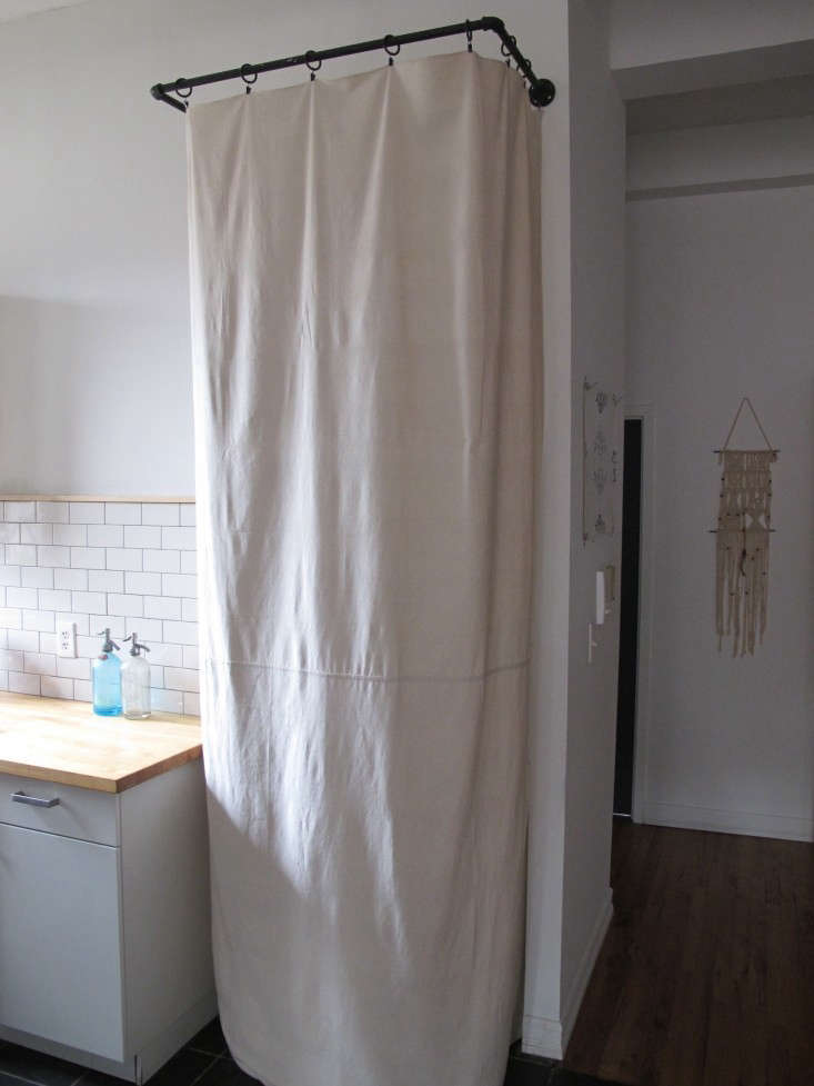 Myles-Tipley-DIY-curtained-laundry-closet-Remodelista-1