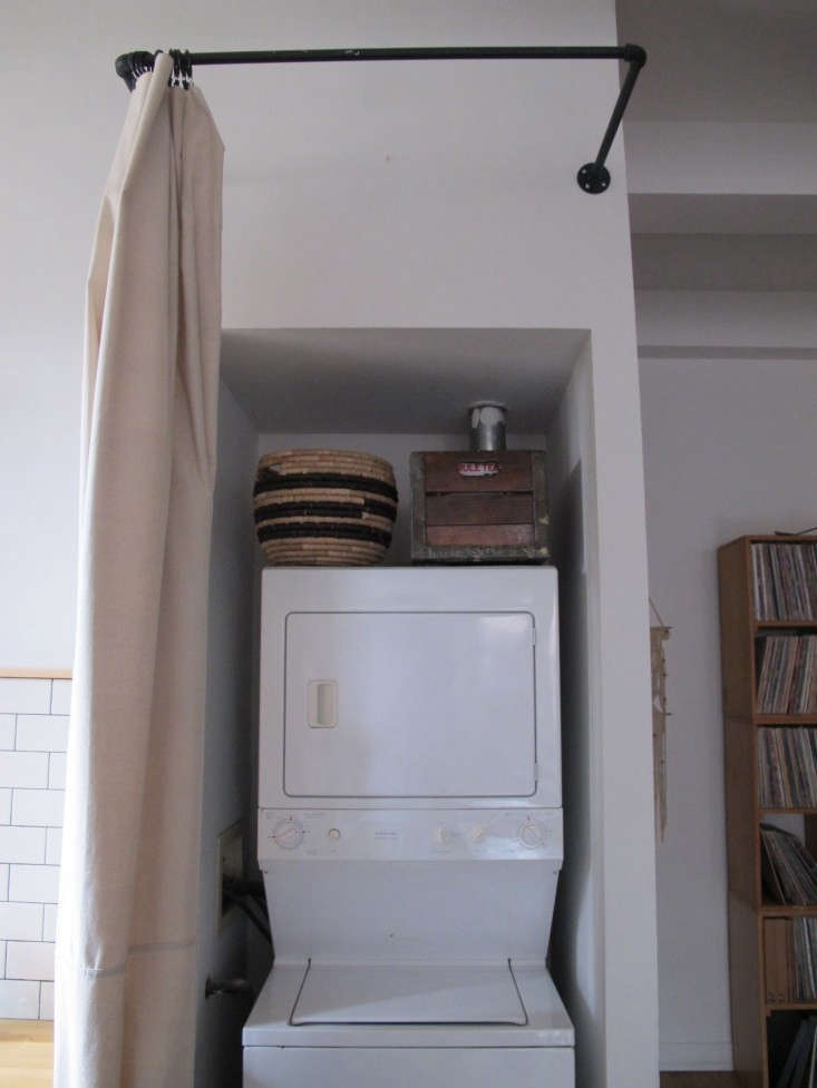 Myles-Tipley-DIY-curtained-laundry-closet-Remodelista-11
