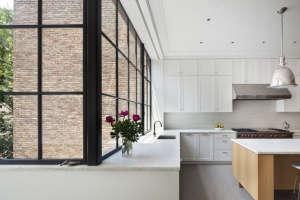 O'neill rose West Side Townhouse, black metal frame windows in kitchen| Remodelista