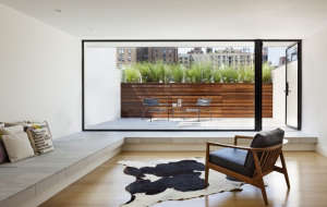 O'neill rose West Side Townhouse, penthouse with cow skin rug on wood floor | Remodelista