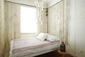 Playland Motel, Rockaway, New York, Dizon Burini bedroom with macrame canopy | Remodelista