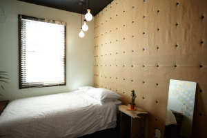 Playland Motel, Rockaway, New York, Javier Polo bedroom with fabric wall | Remodelista
