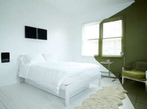 Playland Motel, Rockaway, New York, Simon Spurr bedroom, White room with green corner | Remodelista