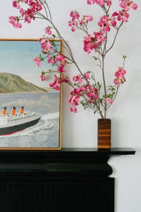 black mantel stillife with Duncan Hannah painting, Remodelista