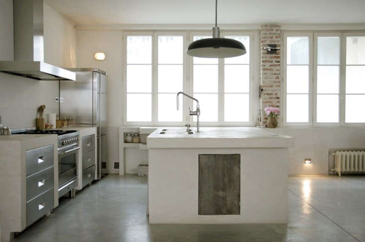 concrete floor kitchen polished iron grey covers of the open plan