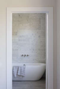 Carrra marble tiles in Venice apartment by SIMO Design | Remodelista