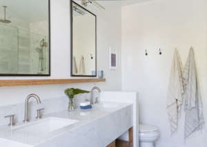 Carrara marble slab vanity in Venice apartment by SIMO Design | Remodelista