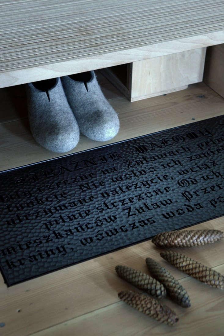 Salvinia-Lodge-Shoes-Entryway-Remodelista