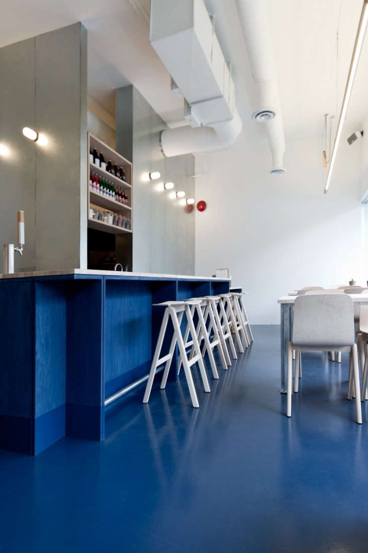At Kin Kao restaurant in Vancouver, architects Scott & Scott installed a new concrete floor tinted with bright blue commercial paint. See the rest in Paint It Blue: A New Wave Thai Restaurant in Vancouver. Photograph by Scott & Scott.
