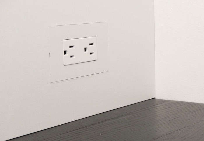 A flush-mount wall plate system for drywall and wood, Smoothline was developed by a remodeler frustrated by the lack of utilitarian elements with a clean, modern design. It's only available in white, but can be painted and wallpapered.