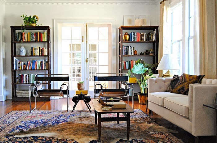 Tearing Up Houses After Living Room Photo with Bookcases and Big Rug, Remodelista
