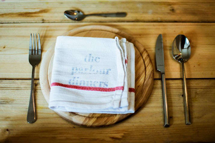 The Parlour Dinners Kitchen Towel on Charger Set for Dinner