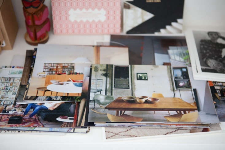Totokaelo-Offices-Michael-Muller–Photos-on-Table-Remodelista