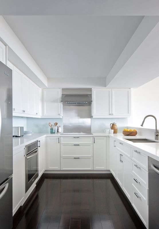 U-shaped-white-kitchen-stainless-steel-appliances-Remodelista