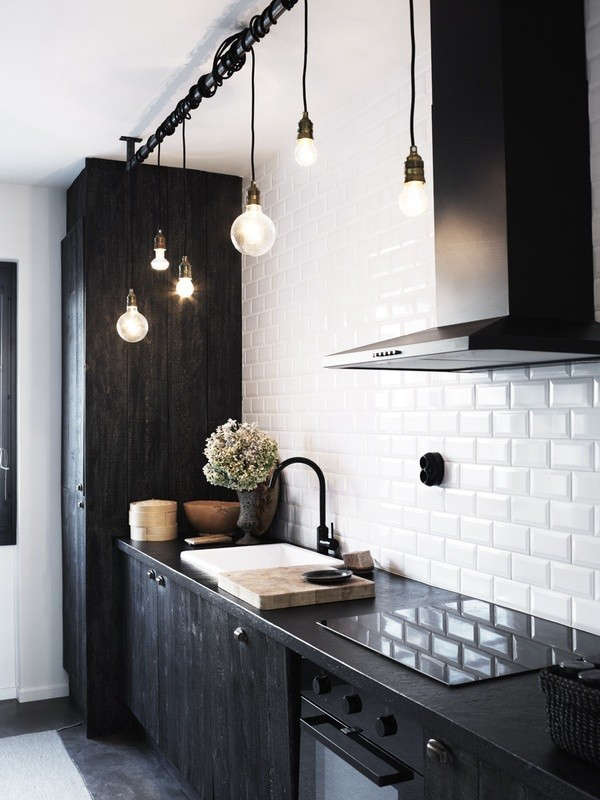 Urban-Galley-Kitchen-Black-Cabinets-and-Countertops-Remodelista