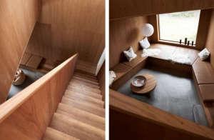 Villa Weinberg, Aarhus, Denmark, wood stairs into wood lined den | Remodelista