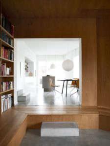 Villa Weinberg, Aarhus, Denmark, wood lined den, concrete sleepers as steps into kitchen, concrete floors, Noguchi Akari Pendant | Remodelista