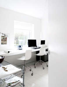 Villa Weinberg, Aarhus, Denmark, white office, white desk, painted white floors, metro shelves  | Remodelista