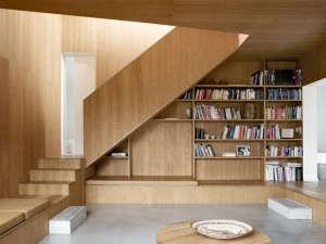 Villa Weinberg, Aarhus, Denmark, wood lined den, concrete floors | Remodelista