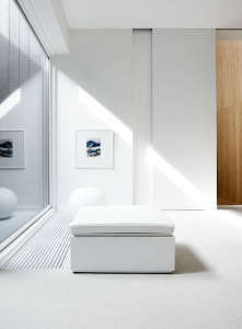 Villa Weinberg, Aarhus, Denmark, white room with white cushion covered white bench, forced air vent in floor | Remodelista