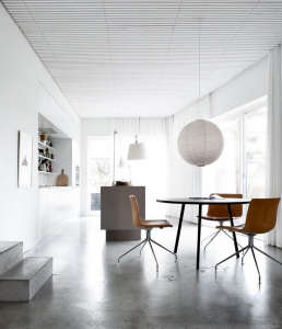 Villa Weinberg, Aarhus, Denmark, Noguchi Akari Pendant above black table, Catifa Chairs by Arper, Concrete Floors, Floor to ceiling white curtains | Remodelista