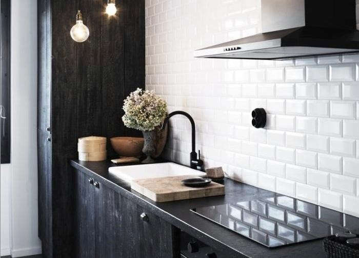 White-Tile-backsplash-black-electric-socket-remodelista