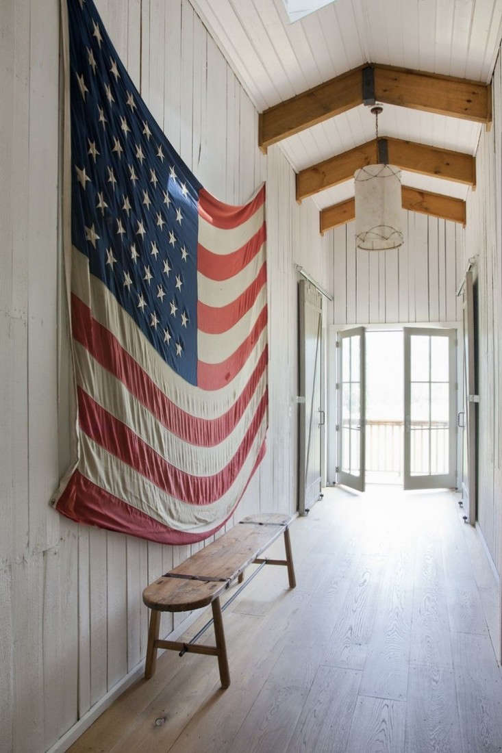 barn-hallway-with-american-flag-remodelista