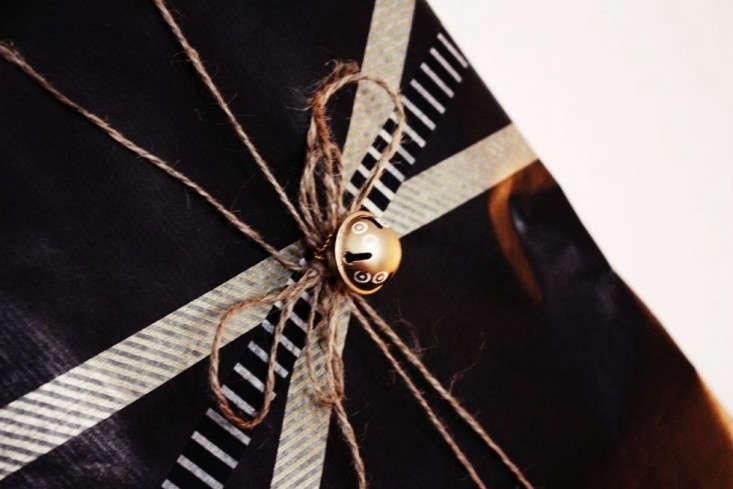 black-gift-wrap-gold-bell-remodelista
