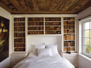 Book shelves above a bed | Remodelista
