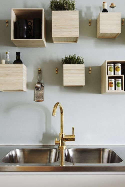 brass-faucet-boxes-on-wall-remodelista