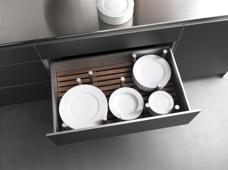 a deep drawer with pegs for plate storage from german company bulthaup. 12