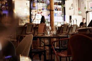 Cafe Kafka in Barcelona, gold column, rattan chairs   Remodelista