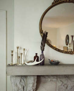 Mantel with Feathers and Antler Remodelista