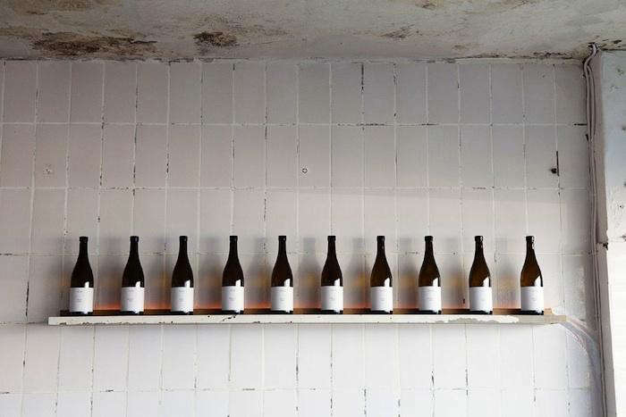 fiskbars-tiled-wall-wine-bottles