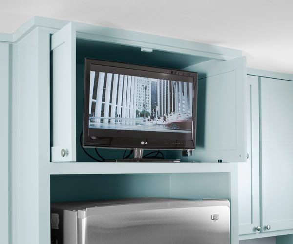 12 elegant solutions for hiding a flat screen tv remodelista for Tv cabinets hidden flat screens