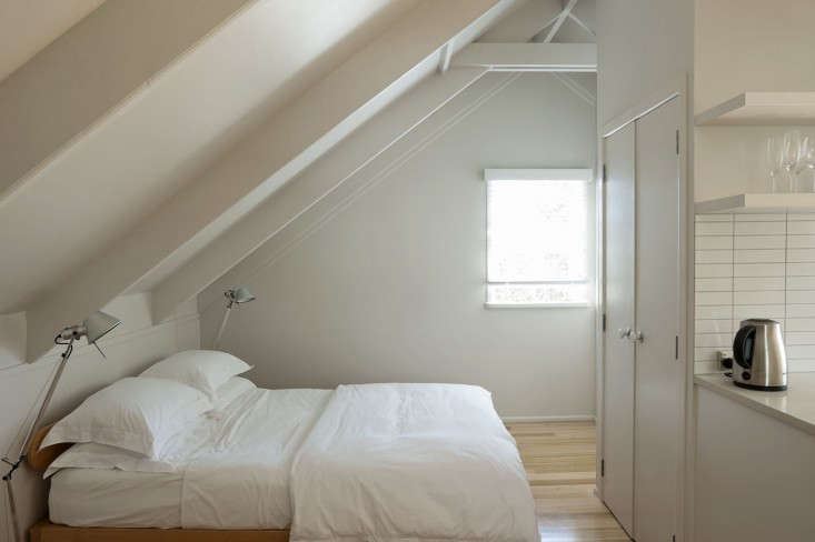 attic alcove ideas - Small Space Living An Airy Studio Apartment in a Garage