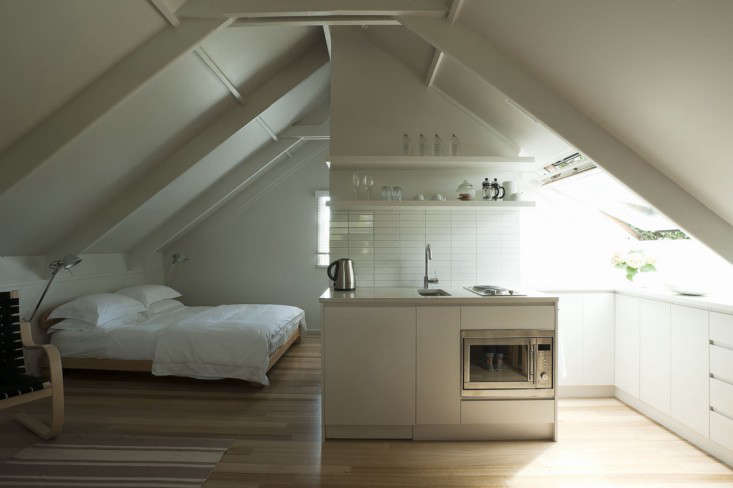 Small Space Living An Airy Studio Apartment In A Garage
