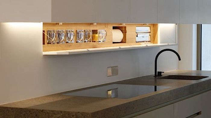 above: a recessed storage area offers space for paper towels and storage drawer 23