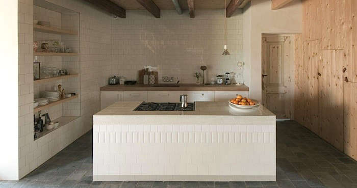 Above While Most Of The Tiles Are Offset In This Kitchen By Netherland Designers Ina Matt A Stacked Row Of Different Sized Tiles Creates A Patterned Band