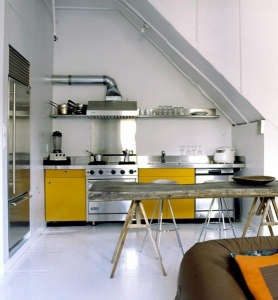 Yellow kitchen cabinets and stainless steel appliances, small kitchen | Remodelista