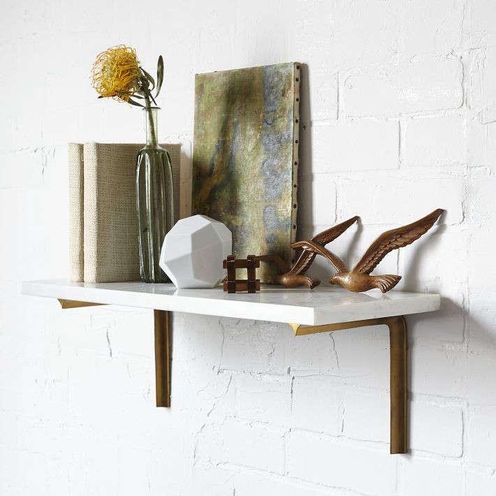 marble-shelf-brass-brackets-remodelista-3