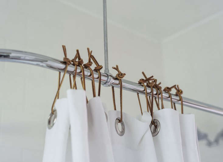 sarah-lonsdale-rental-house-bathroom-leather-shower-curtain-ties-Remodelista