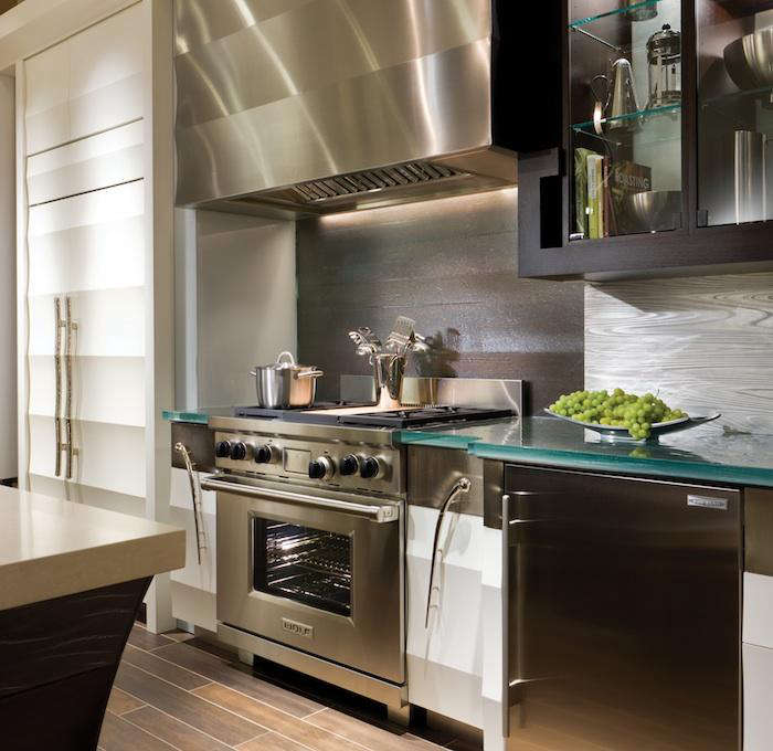 Above A Kitchen At The Sub Zero And Wolf Showroom In The Chicago Merchandise Mart Features Textured Panels On The Refrigerator And Range Hood