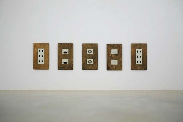 tomoaki-wall-outlets-aged-brass-remodelista